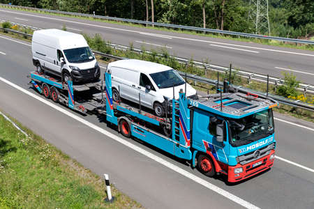 Mosolf Mercedes-Benz Actros car-carrying truck on motorway. Archivio Fotografico - 156764506