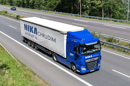 NIKA DAF XF truck with curtainside trailer on motorway. Editoriali