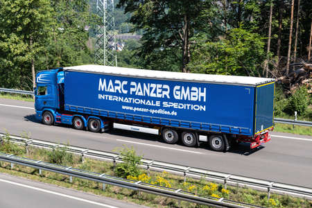 Marc Panzer Scania truck with curtainside trailer on motorway. Archivio Fotografico - 156764502