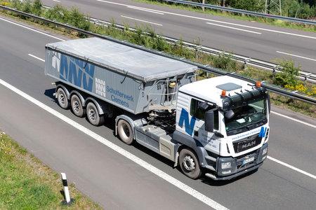 Schotterwerk Clemens MAN TGS truck with tipper trailer on motorway. Archivio Fotografico - 156764516