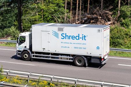 Shred-it truck on motorway. Archivio Fotografico - 156764518