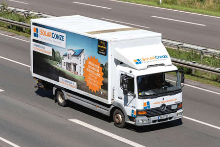 Solar Conze Mercedes-Benz Atego truck on motorway. Editoriali