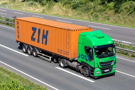 Jost Iveco Stralis truck with ZIH container on motorway.