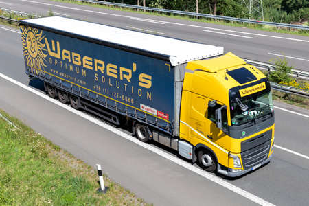 Waberer's Volvo FH truck with curtainside trailer on motorway. Editoriali