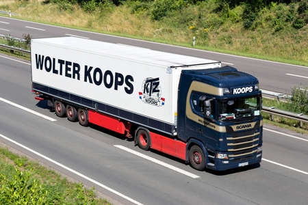 Wolter Koops Scania S450 truck on motorway. Wolter Koops is a Dutch service provider in temperature-controlled transport and logistics. Editoriali