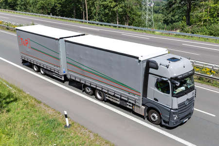 T&P Mercedes-Benz Actros combination truck on motorway.