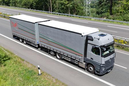 T&P Mercedes-Benz Actros combination truck on motorway. Archivio Fotografico - 156764449