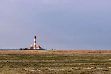 Westerheversand lighthouse in Schleswig-Holstein, Germany. Archivio Fotografico - 157274384