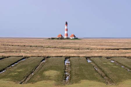 Westerheversand lighthouse in Schleswig-Holstein, Germany. Archivio Fotografico - 157274383