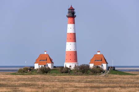 Westerheversand lighthouse in Schleswig-Holstein, Germany. Archivio Fotografico - 157274386