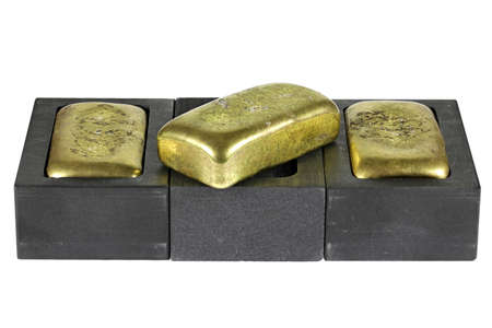 graphite molds with gold bars isolated on white background
