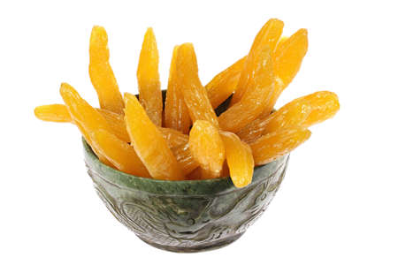 dried sweet potatoes in a vintage jade bowl isolated on white background