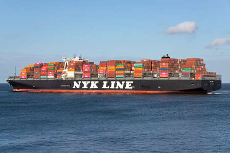 NYK OWL on the river Elbe. Nippon Yusen Kabushiki Kaisha (NYK) is one of the oldest and largest shipping companies in the world.