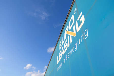 Euroleasing logo at curtain side semitrailer against blue sky. Editoriali