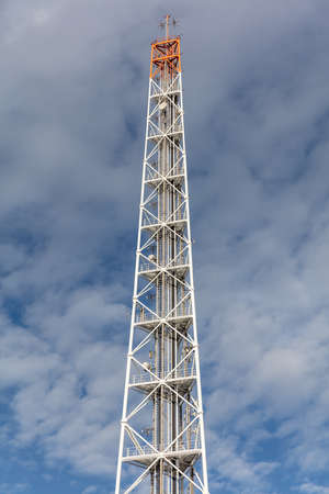 radio mast against cloudy sky