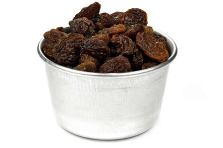 raisins in an aluminium bowl isolated on white background