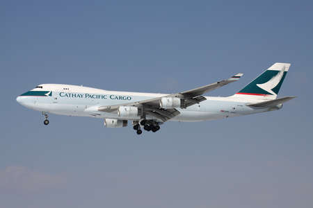 Cathay Pacific Cargo Boeing 747-400F with registration B-HUH on short final for runway 25L of Frankfurt Airport.