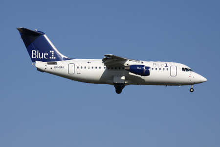 Finnish Blue1 Avro RJ85 with registration OH-SAK on short final for runway 01 of Brussels Airport. Publikacyjne