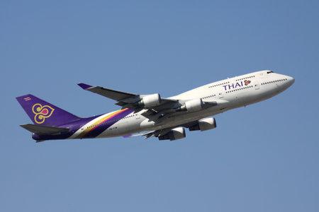 Thai Airways Boeing 747-400 with registration HS-TGM airborne at Frankfurt Airport.
