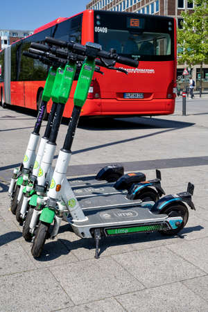 Lime electric scooters on sidewalk Editorial