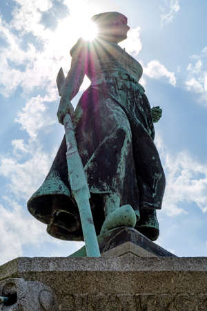 bronze statue Asmussen-Woldsen Monument at the market of Husum, Germany