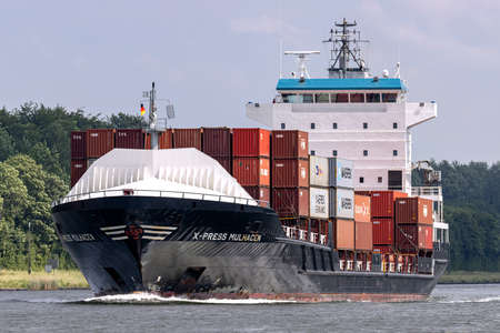 container ship X-PRESS MULHACEN in the Kiel Canal Editorial