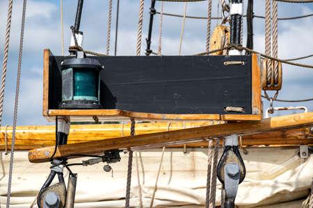 green starboard navigation light aboard a tall ship Standard-Bild