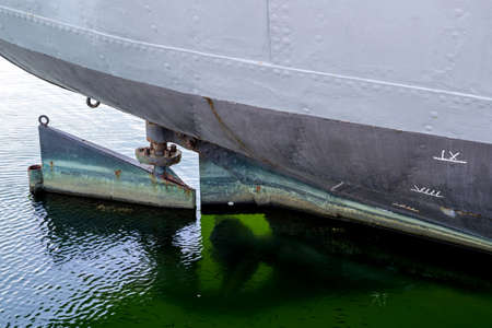 rudder of an old freight ship with reveted hull