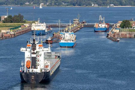 ships in the Kiel canal with Holtenau Locks in the background