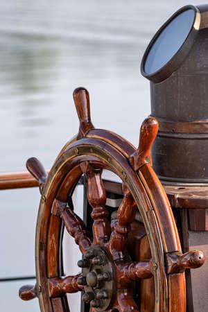 wooden ship's wheel of a tall ship Standard-Bild