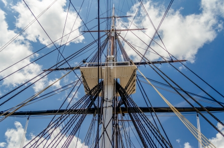 Ship Mast of the USS Constitution Warship, against a blue sky