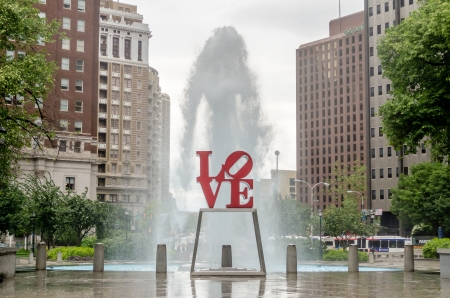love park: Love Statue in Philadelphia, with scenic fountain against a cloudy sky Editorial