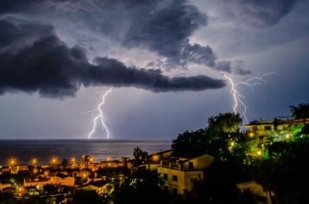 Lightning over the sea, night scene 写真素材