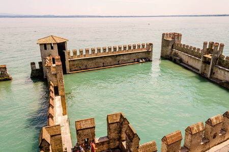 Scaliger Castle extending over the Garda Lake, Sirmione, Italy Stock Photo