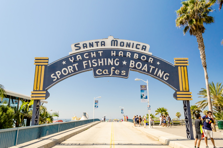 wooden dock: Santa Monica iconic entrance arch, California