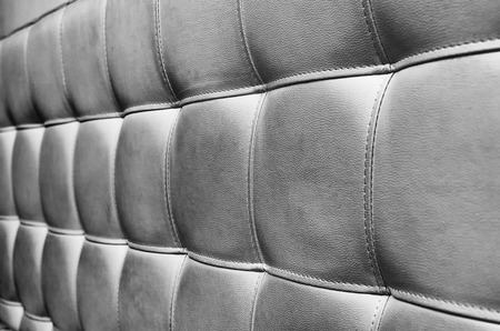 headboard: Tufted Grey Leather Headboard Texture, used for Background Stock Photo