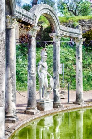 adriana: Greek Statue of Ares overlooking the ancient pool called Canopus, inside Villa Adriana (Hadrians Villa), Tivoli, Italy Stock Photo
