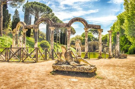 adriana: The Ancient Pool called Canopus, surrounded by greek sculptures in Villa Adriana (Hadrians Villa), Tivoli, Italy