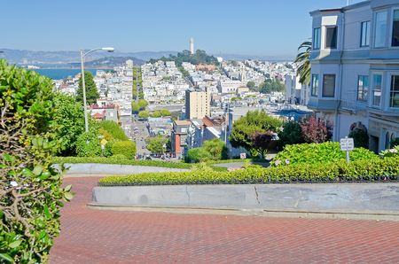 coit: SAN FRANCISCO - AUG 11 : View of Lombard Street in San Francisco California on August 11, 2012. The street is famous for a steep, one-block section with eight hairpin turns