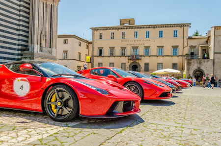 ORVIETO, ITALY - JUNE 28, 2015 - Hundreds of Ferrari supercars gathering in front of the Orvieto Cathedral on June 28, 2015, during the Ferrari Cavalcade 2015 event.