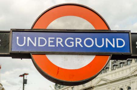 kilometres: LONDON - MAY 28: Subway sign in London, May 28, 2015. The London Subway system serves 270 stations and has 402 kilometres (250 mi) of track.