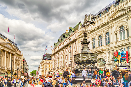eros: LONDON - MAY 28:Tourists gather around the statue of Eros at Picadilly Circus May 28, 2015 in London. The Circus is close to major shopping and entertainment areas in the West End