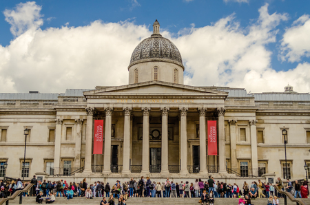 typically british: LONDON - MAY 28: Tourists in Trafalgar Square outside the National Gallery, May 28, 2015 in London. Founded in 1824, the National Gallery is one of the most visited museum in the world