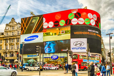 LONDON - MAY 28:  Illuminated signs in Piccadilly Circus on May 28, 2015 in London. The site has six illuminated advertising screens above three large retail units facing Piccadilly Circus on the north side