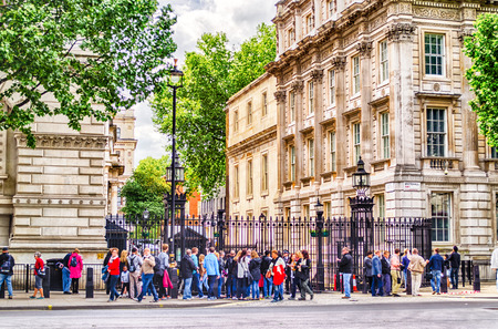 david brown: LONDON MAY 28: Tourists outside the gate of Downing Street in London on May 28, 2015. 10 Downing Street is the official office of the British Prime minister