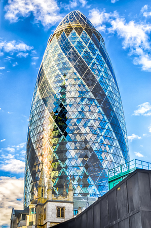 LONDON - MAY 29: The Gherkin building (30 St Mary Axe) in London on May 29, 2015. Iconic landmark of London, this is one of the citys most widely recognized examples of modern architecture. Editorial
