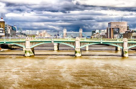 southwark: London Cityscape with Tower Bridge over Southwark Bridge, UK Stock Photo