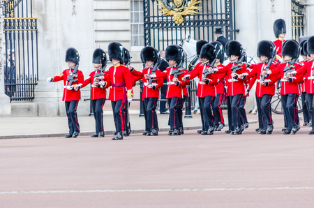 LONDON - MAY 30:  The guard ceremony at Buckingham Palace on May 30, 2015 in London, which is one of Englands most popular visitor attractions.