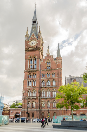eurostar: LONDON - MAY 31: St Pancras Station with unidentified people on May 31, 2015 in London. One of the main stations, at opening 1868 the arched Barlow train shed was largest single-span roof in the world