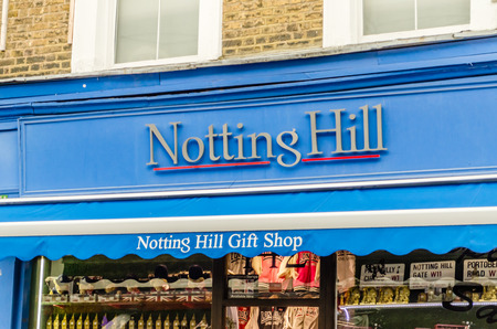"""hugh: LONDON - MAY 31: The sign of a gift shop that was the set for Hugh Grants book shop in the film """"Notting Hill"""", London, May 31, 2015. The shop is located at 142 Portobello Road, London W11"""